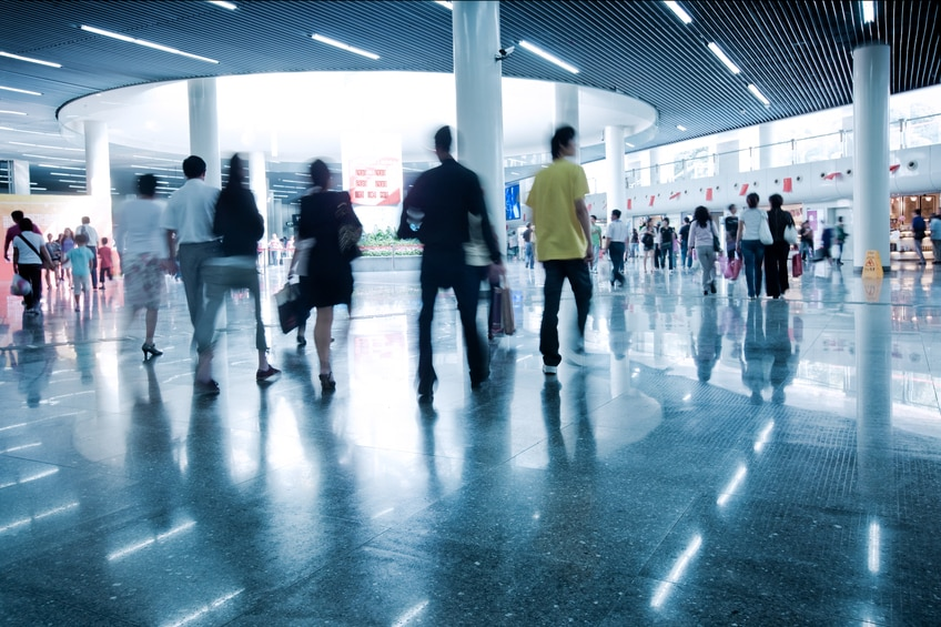 """clean tiled floor, reflection of light on floor and blurred view of people walkingPeople's Square, Shanghai Subway Station"""