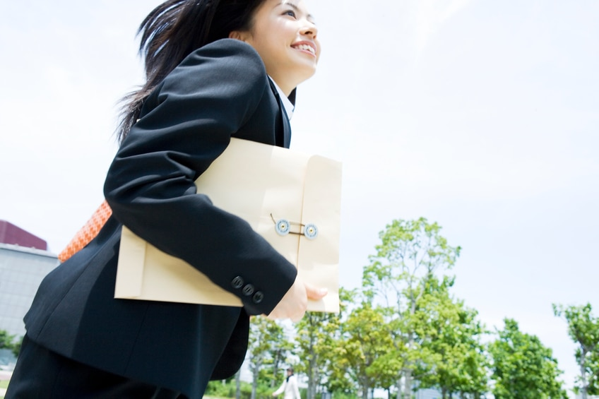Business woman running with documents