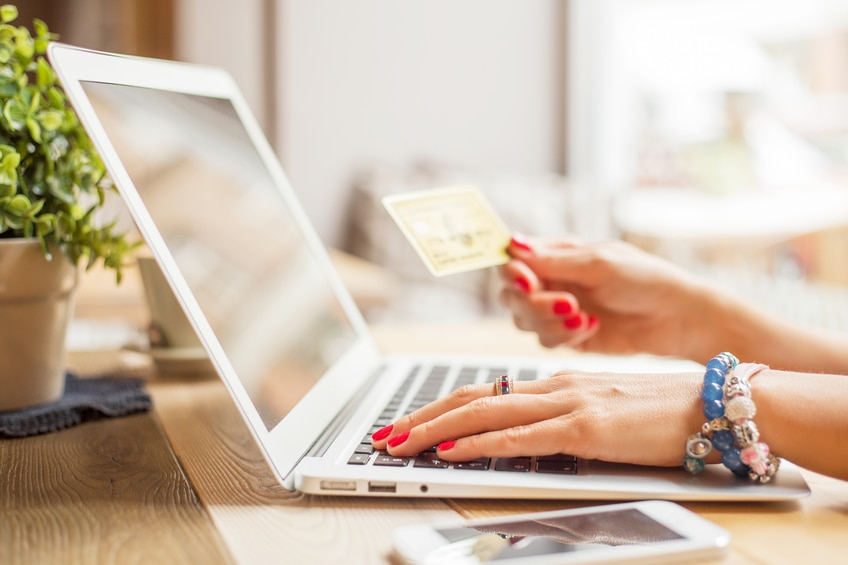 Woman with computer shopping online
