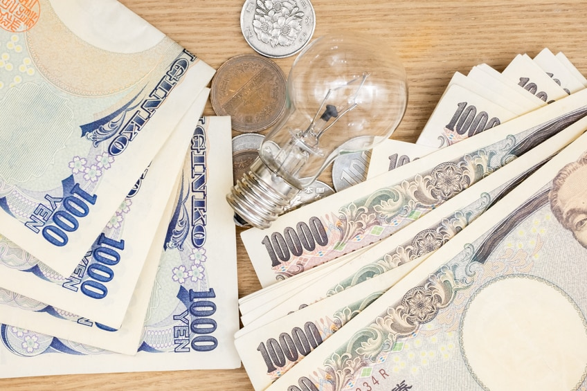 Concept of currency Japanese Yen and lamp for money idea