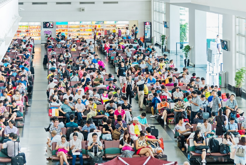 Large group of people waiting in airport for boarding. china