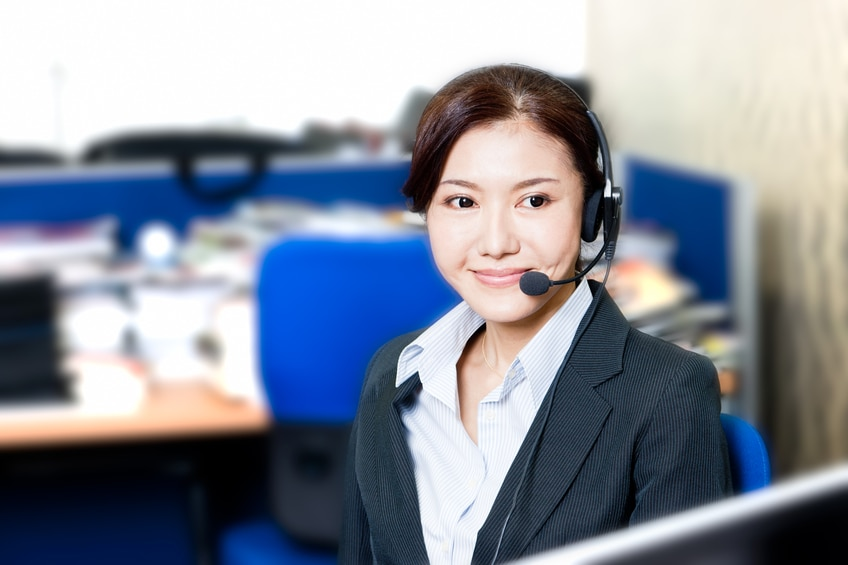 Beautiful business customer service woman, smiling in an office.