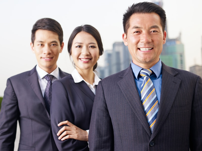 portrait of an asian business team, focus on the man in front.